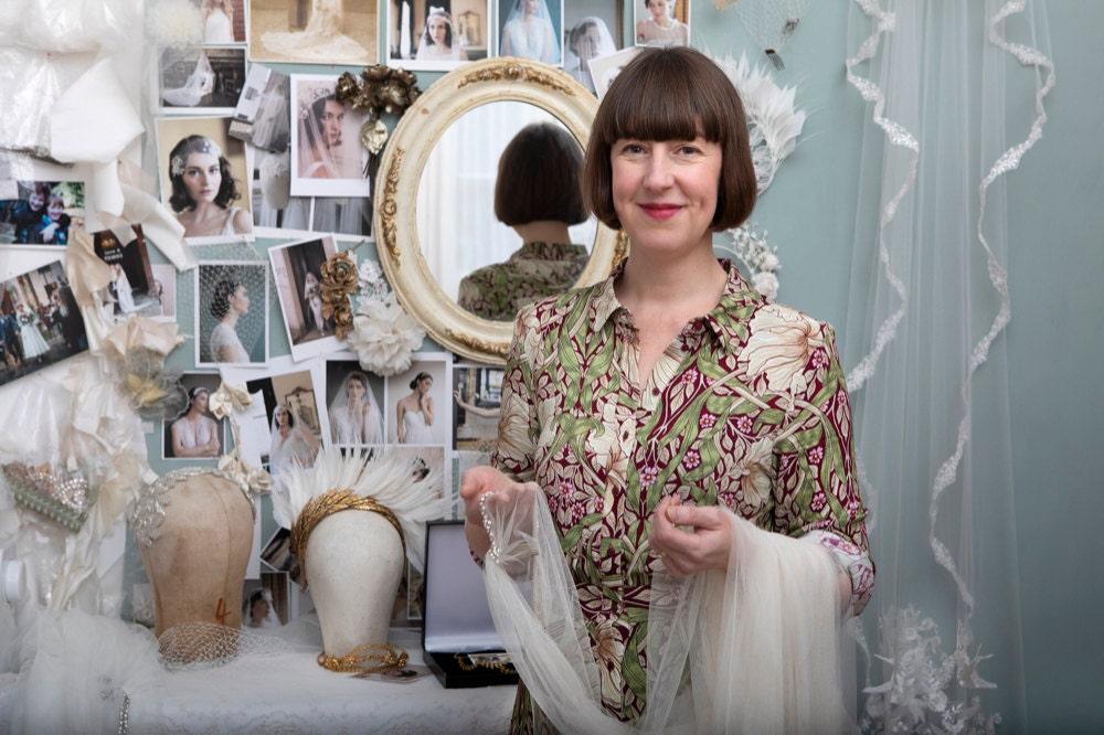 Portrait of Agnes Hart bridal headpiece designer Rae Birch Carter in her studio
