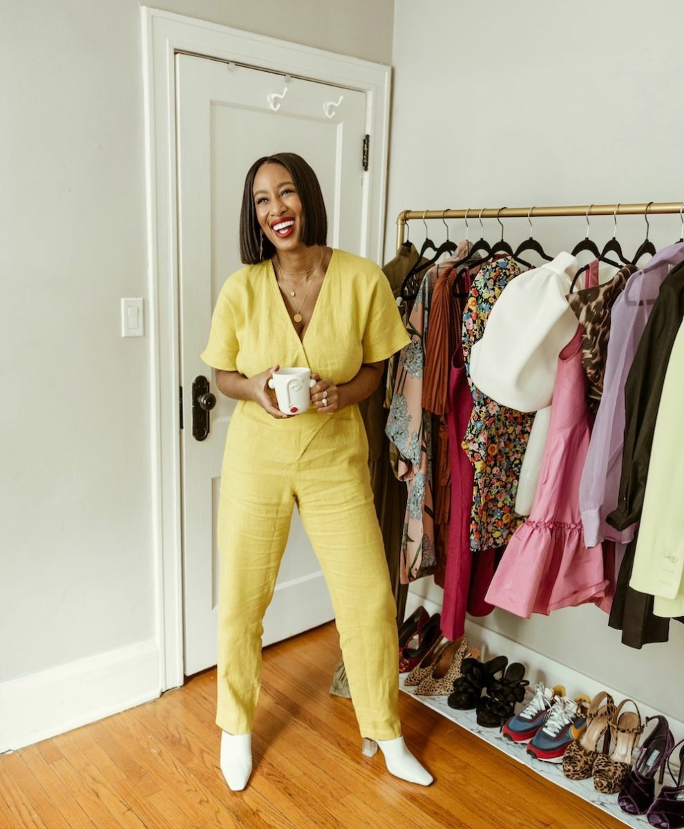 Shay wearing a bright yellow linen jumpsuit