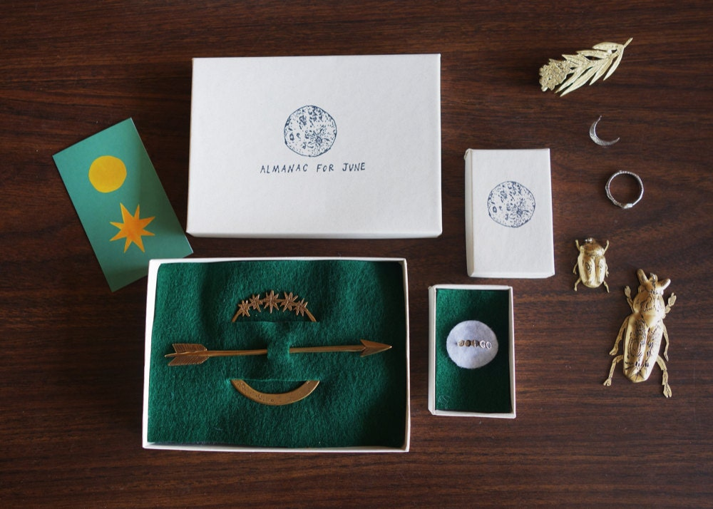 Finished Almanac for June pieces displayed in their packaging