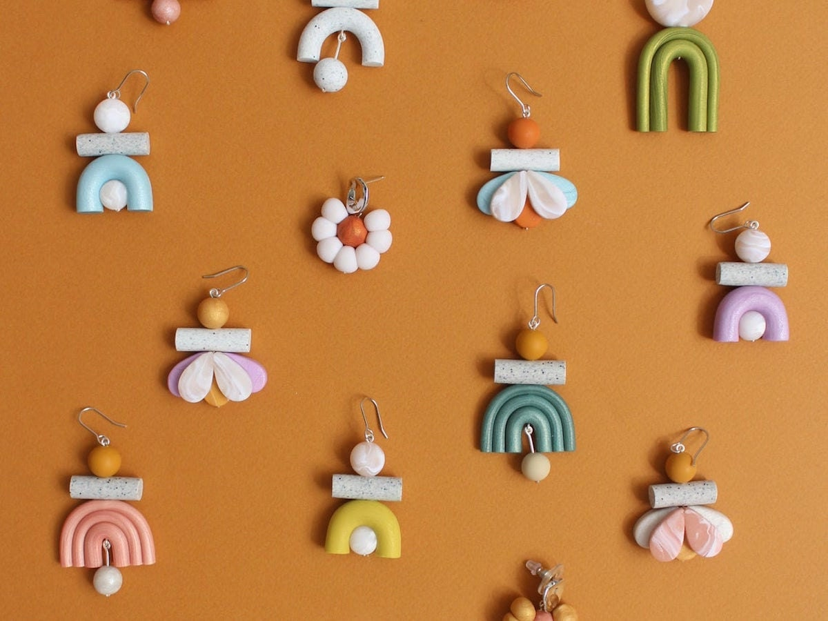 A flat lay of colorful polymer clay statement earrings from TSUNJA