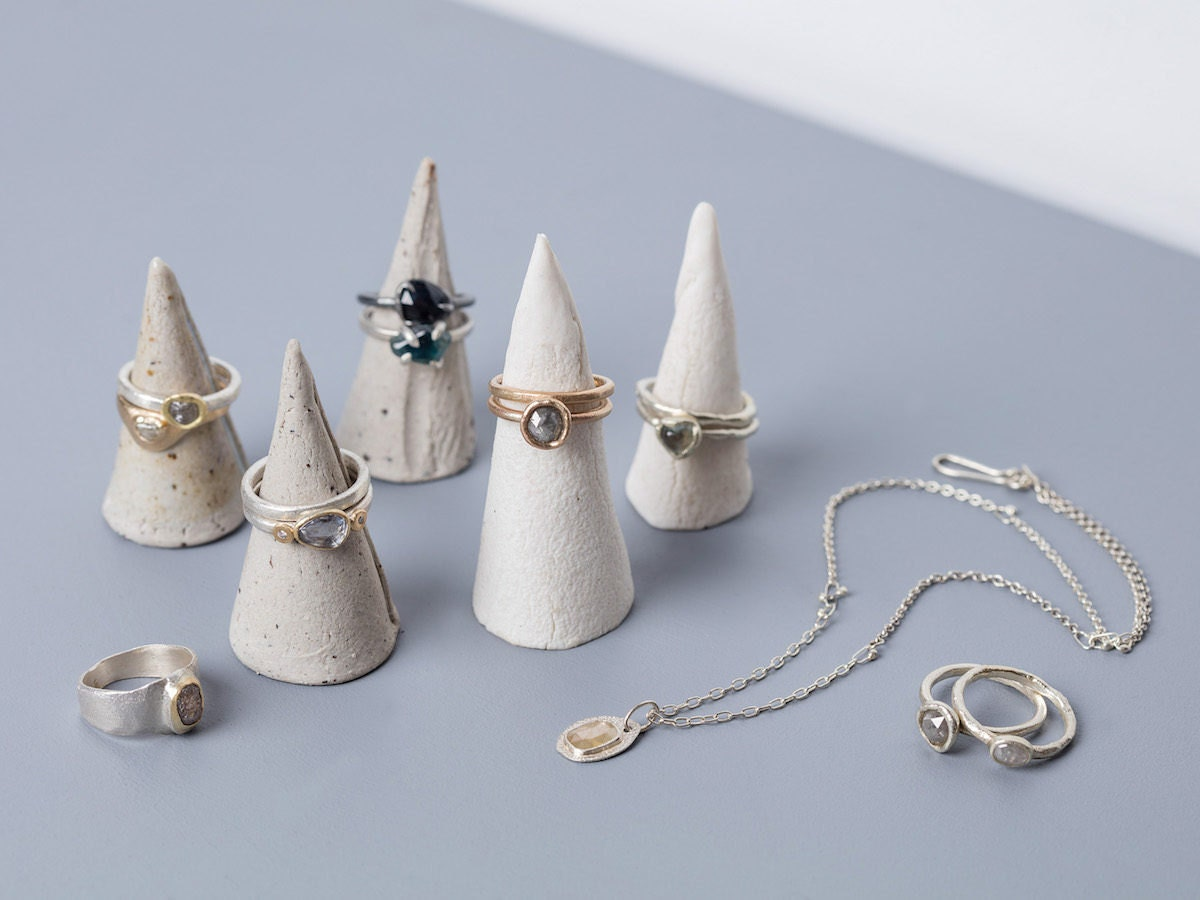 Assorted rings and necklaces from Tamara Gomez on display