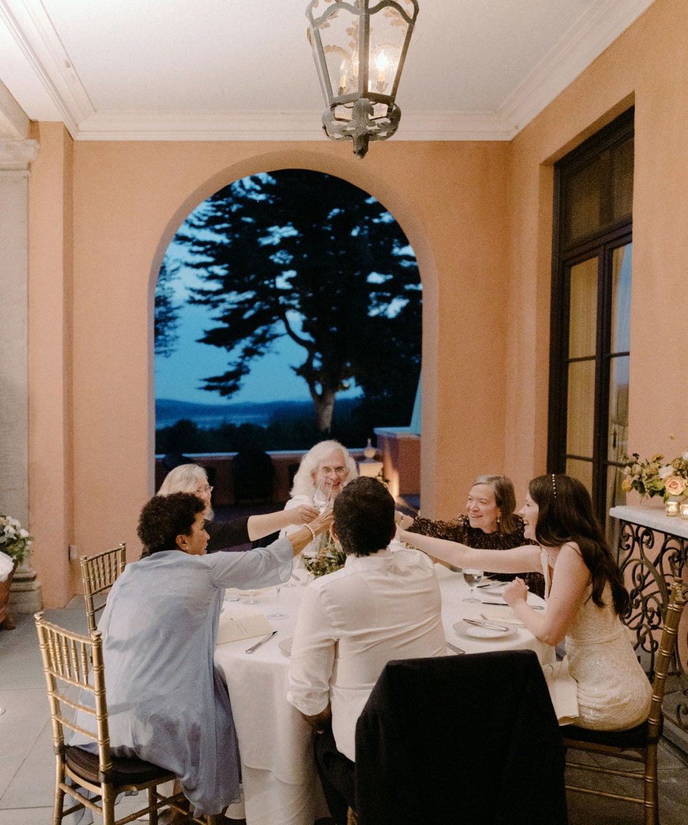 Megan and Imran and their parents enjoy dinner and drinks on the terrace.