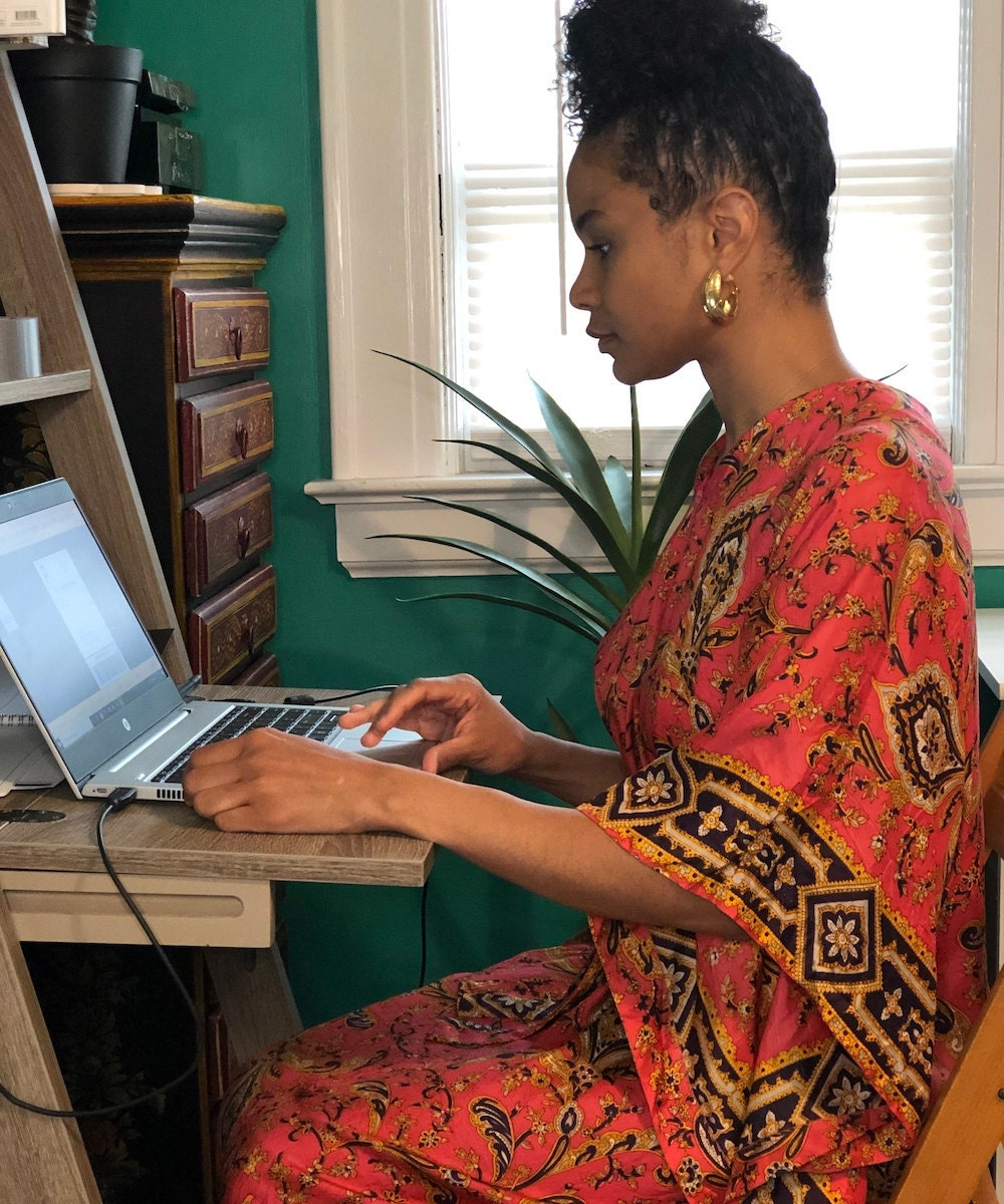 Halima fulfilling orders at her computer