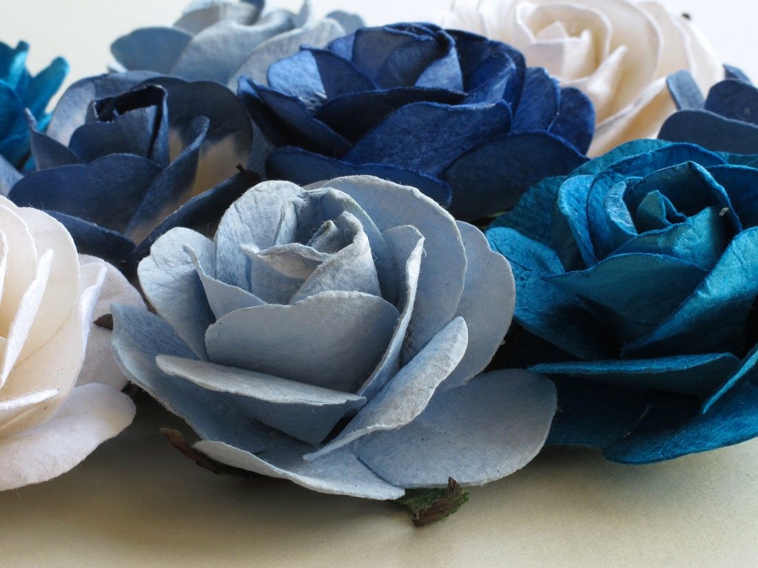 Details and texture on a selection of paper flowers in various shades of blue