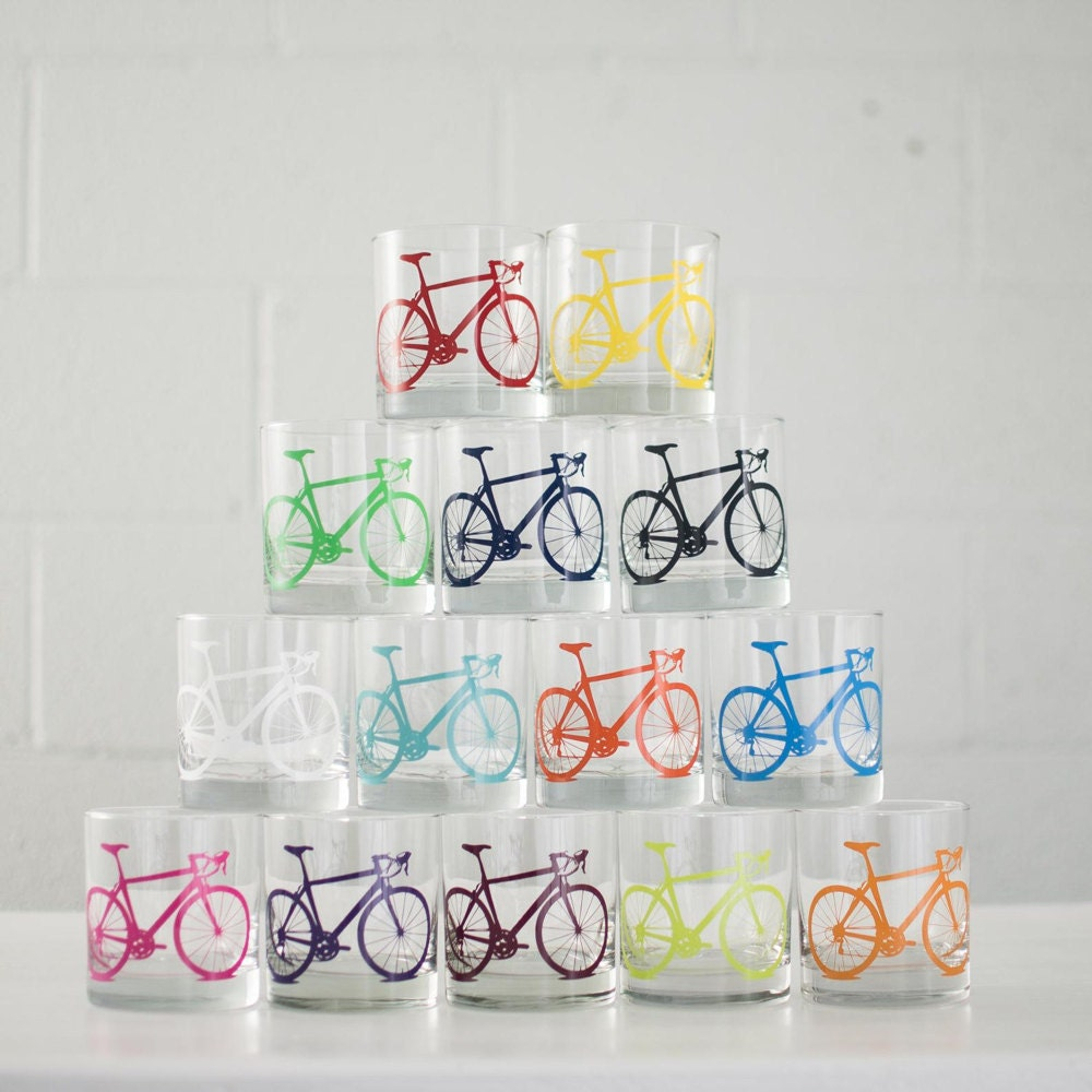 A stack of colorful bicycle highball glasses.