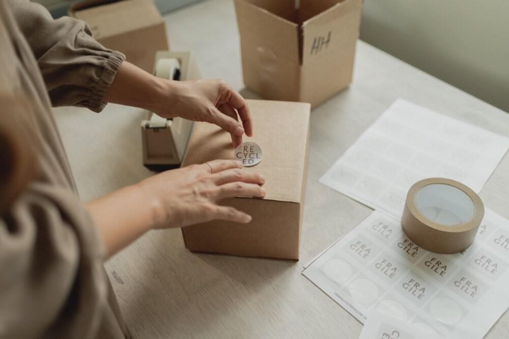 Mara packages orders in her shop.