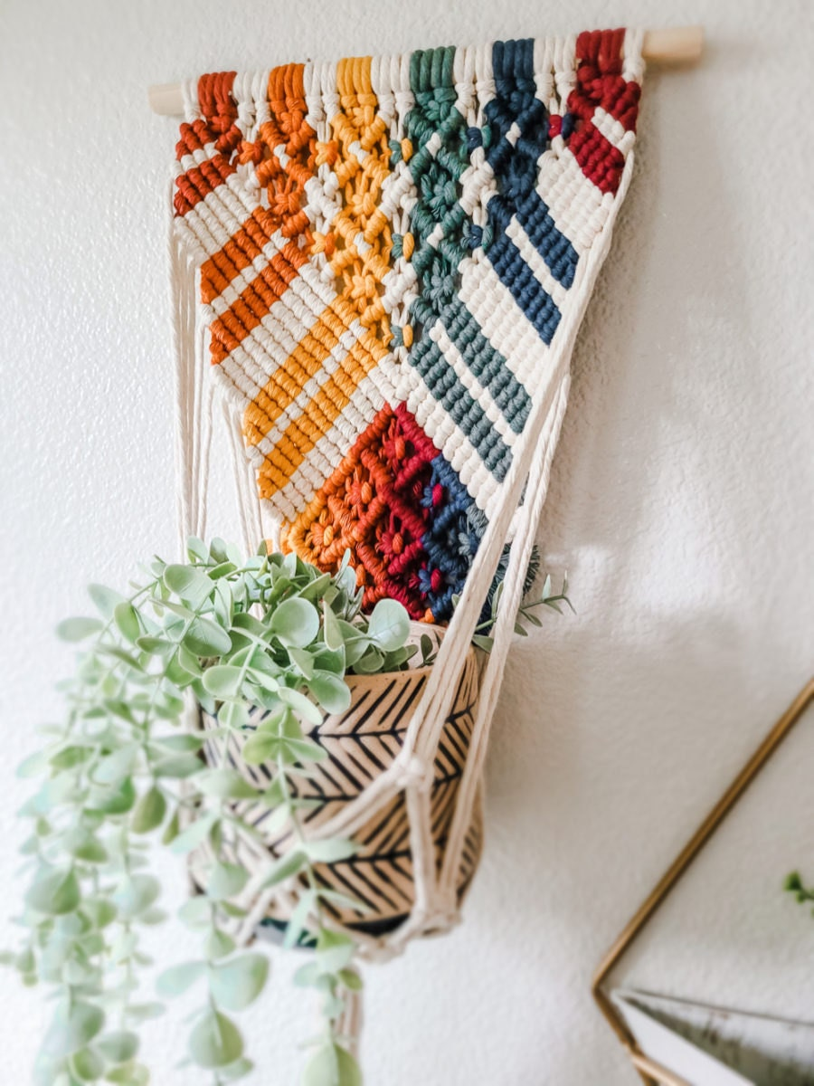 A rainbow hanging planter from Sweet Home Alberti.
