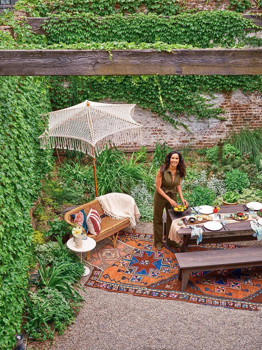Padma Lakshmi sets the table outside