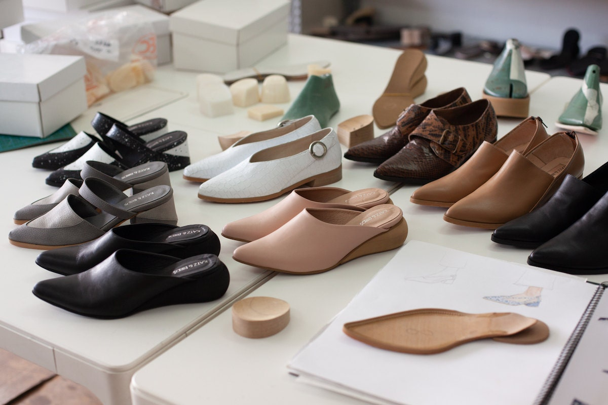 Several pairs of shoes arranged on a table in the Katz and Birds studio