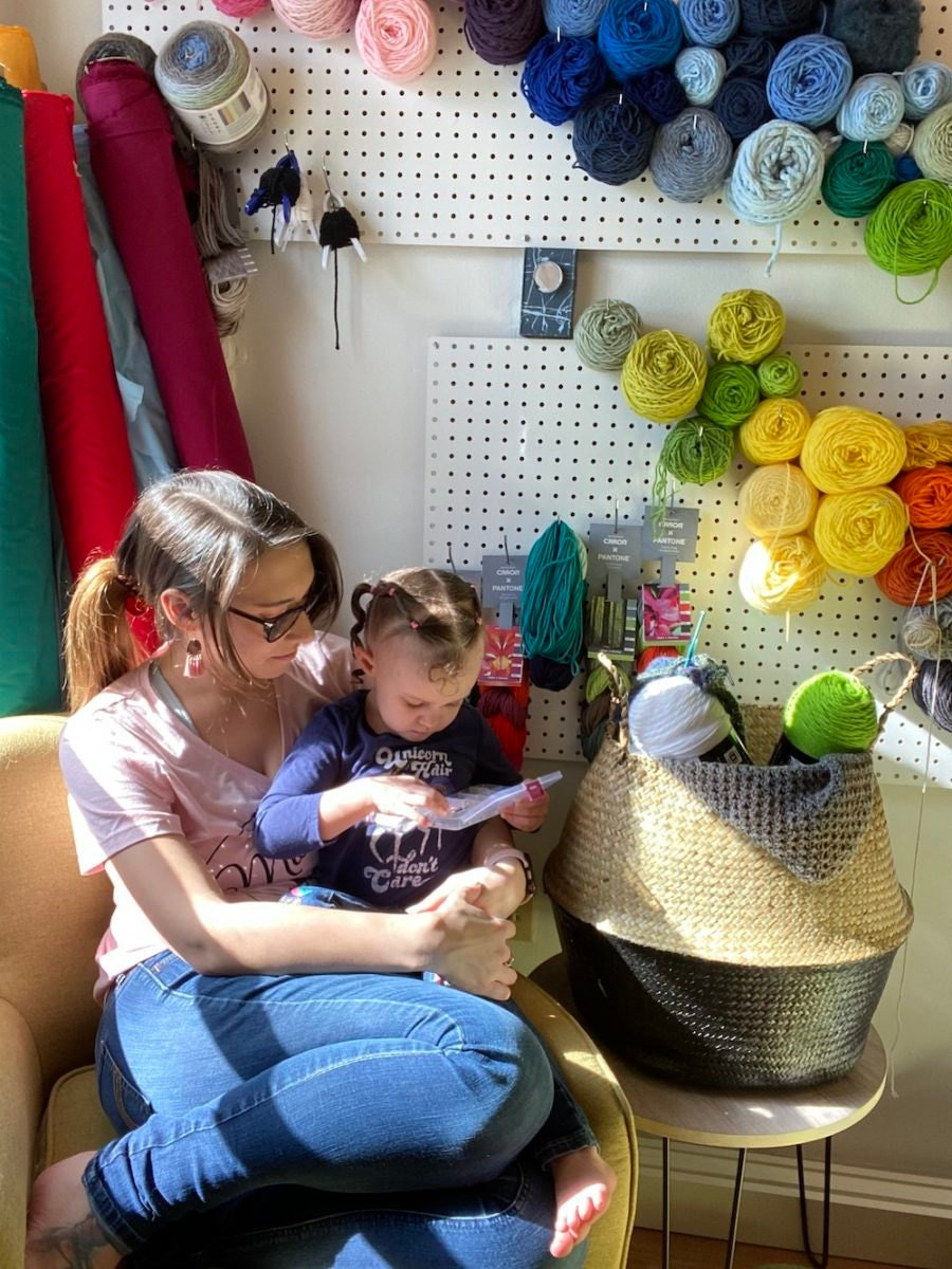 A portrait of Etsy Vetting Team Lead  Amber-Rae Rowley and her daughter