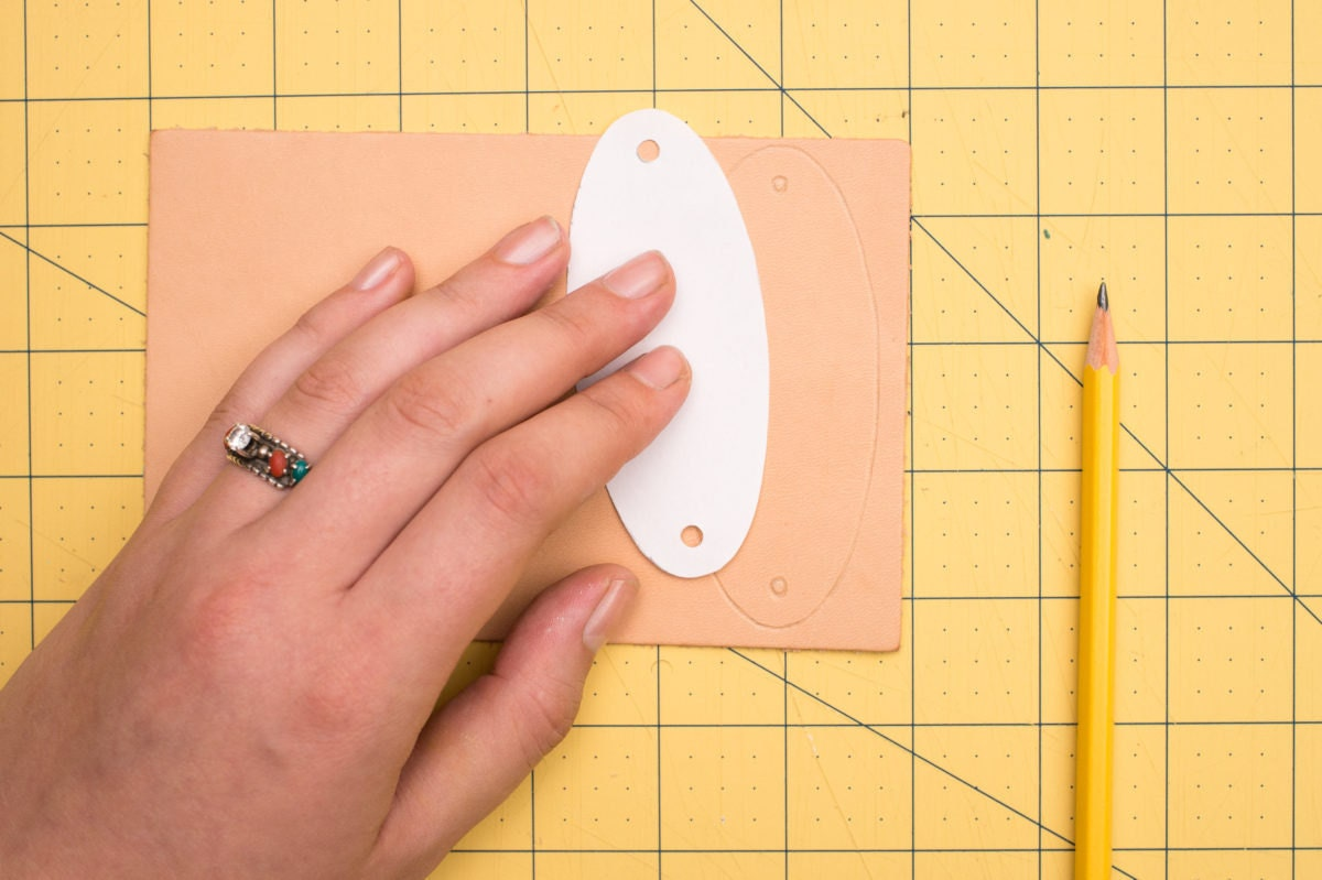 Tracing the template onto leather
