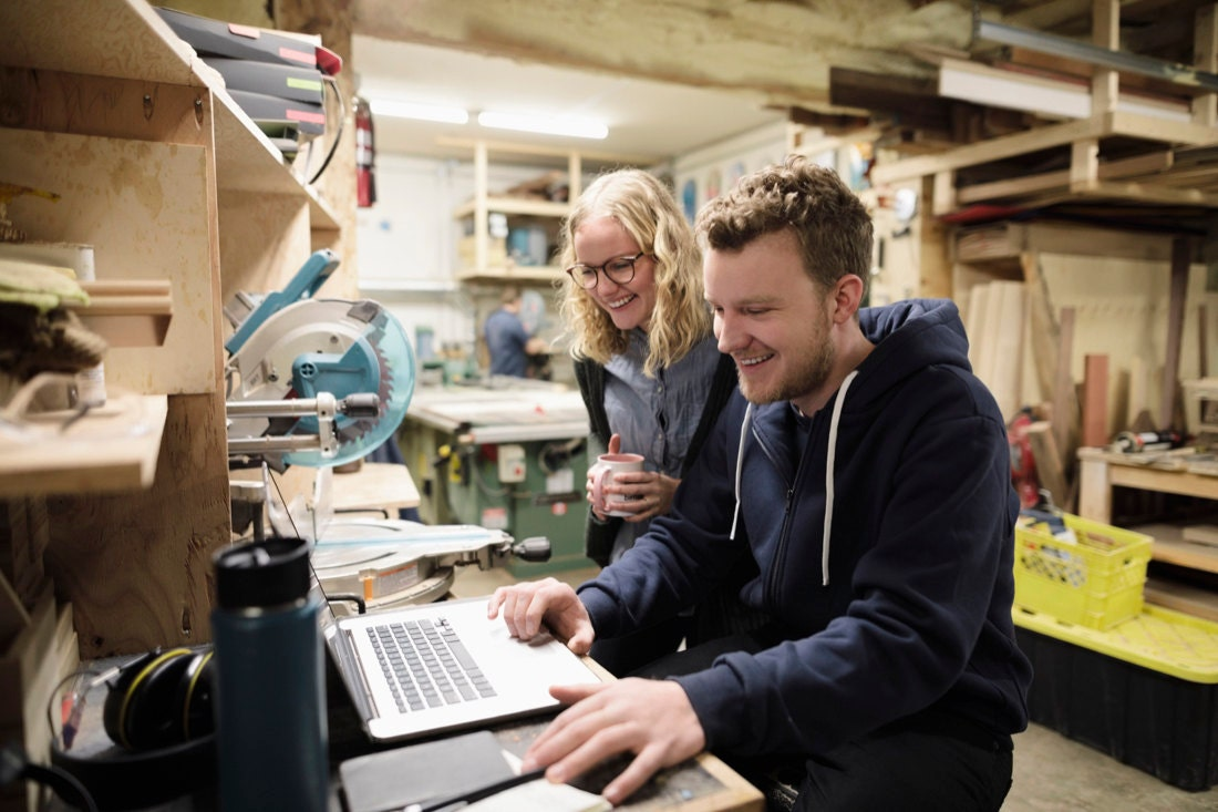 Anne and Adrian work on orders on the computer.