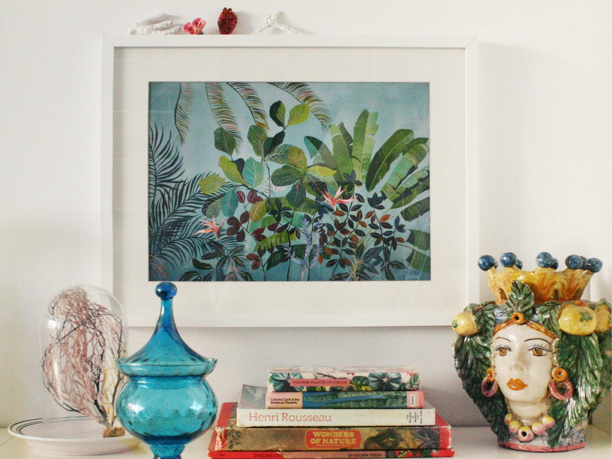 A framed botanical print from Art and People, styled and hanging on the wall.