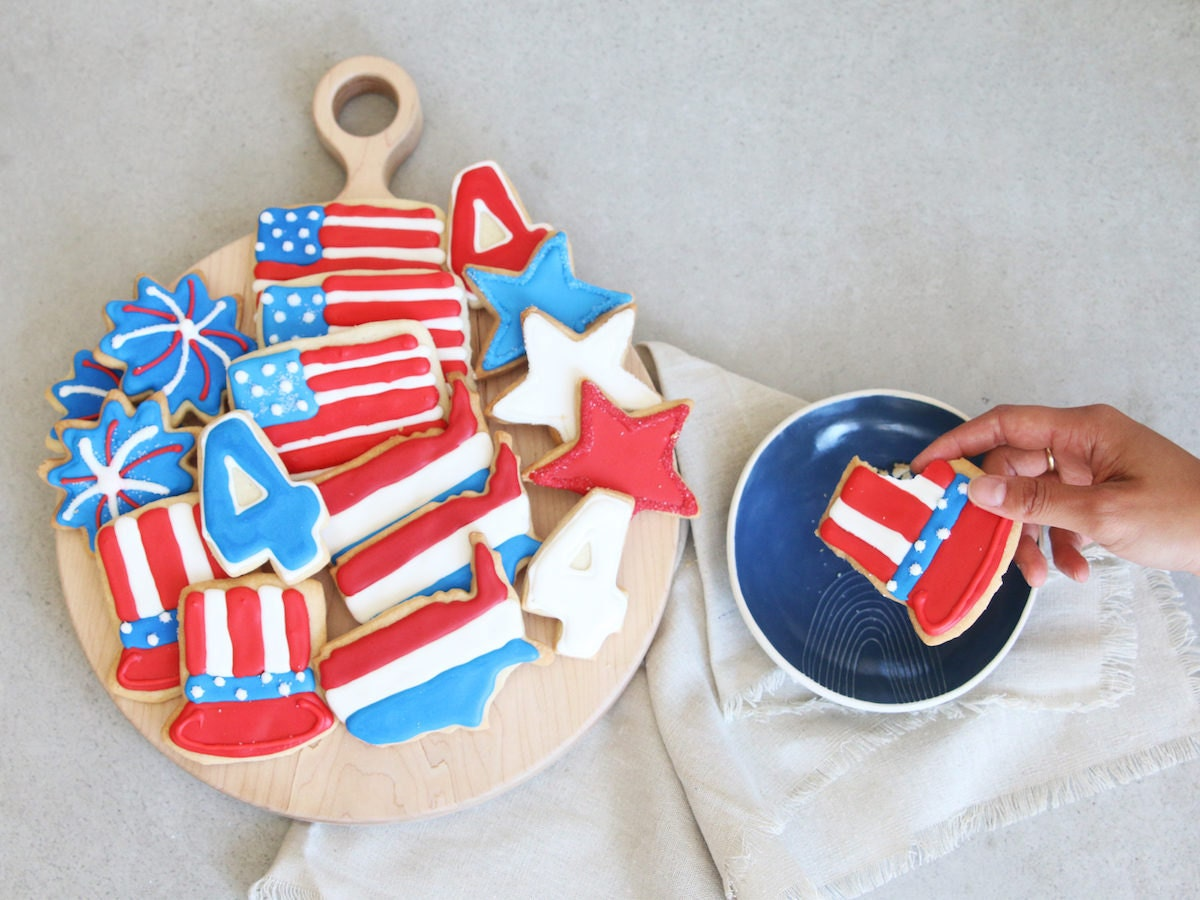 Assorted red, white, and blue-frosted Fourth of July cookies from Sugar & Flour