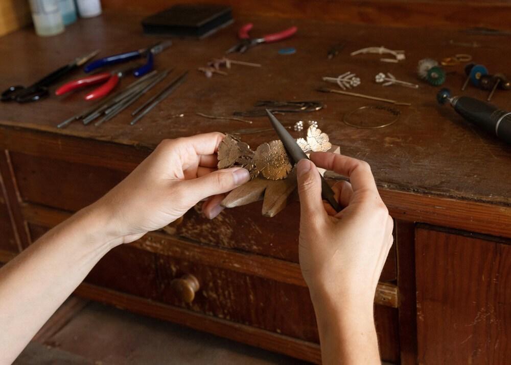 Jieun working on a hair clip at her workbench