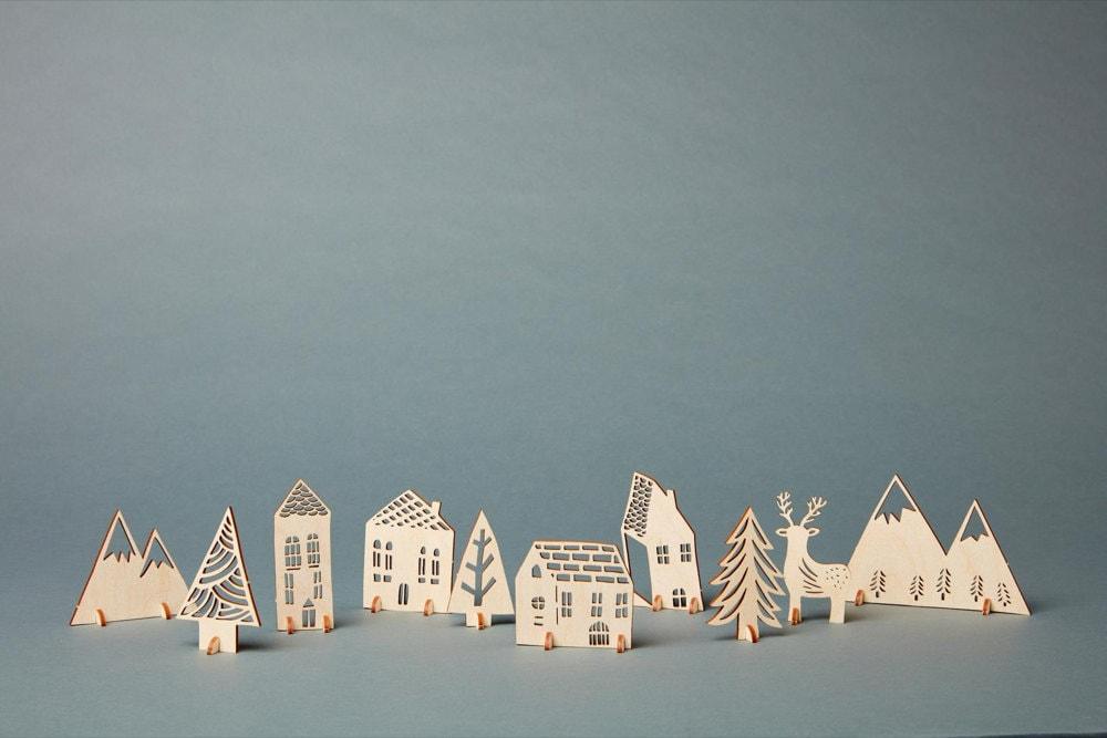 Pop-out 3-D wooden winter village from Light + Paper