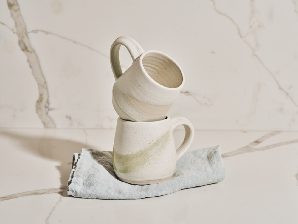 Stacked stoneware wabi-sabi mugs from the Tan France x Etsy collection