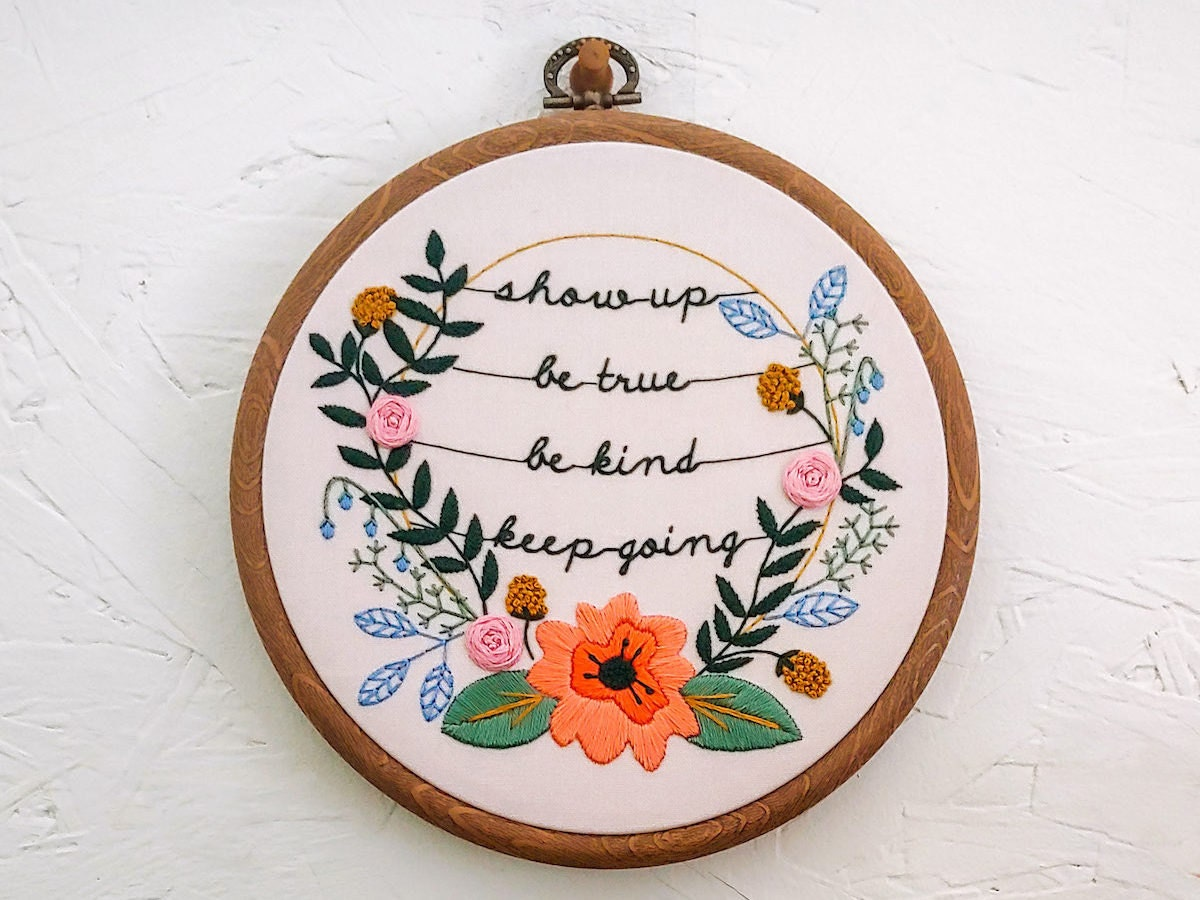 An embroidery hoop from Cozy Blue stitched with the message