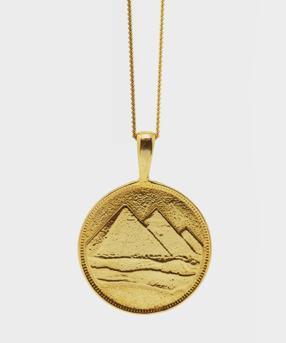 A pyramid charm necklace from Omi Woods