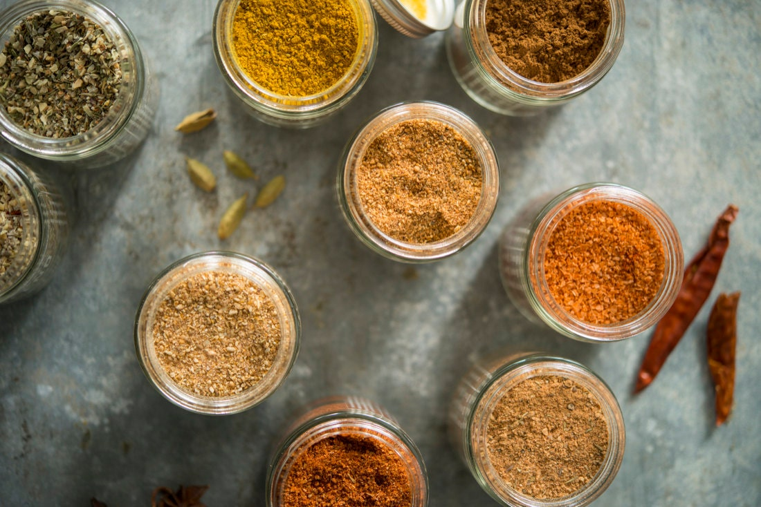 Open jars of spices from Calicutts Spice Co.