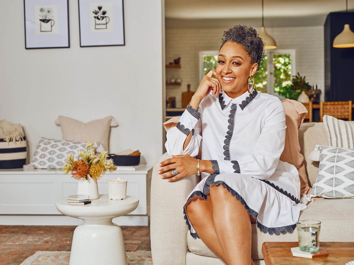 Tia Mowry-Hardrict surrounded by items from the Tia Mowry x Etsy collection