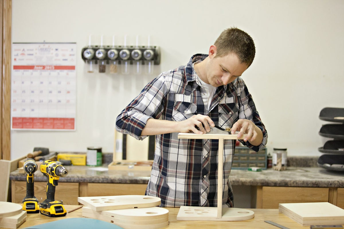 Jesse Bannor in the Bannor Toys workshop, assembling a toy