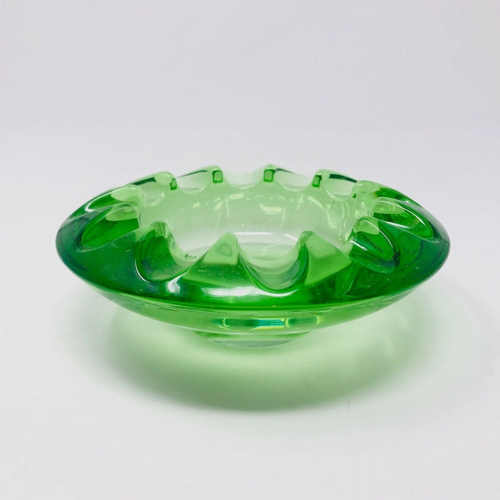 A green glass catchall from Vintage Retro Cupboard on Etsy