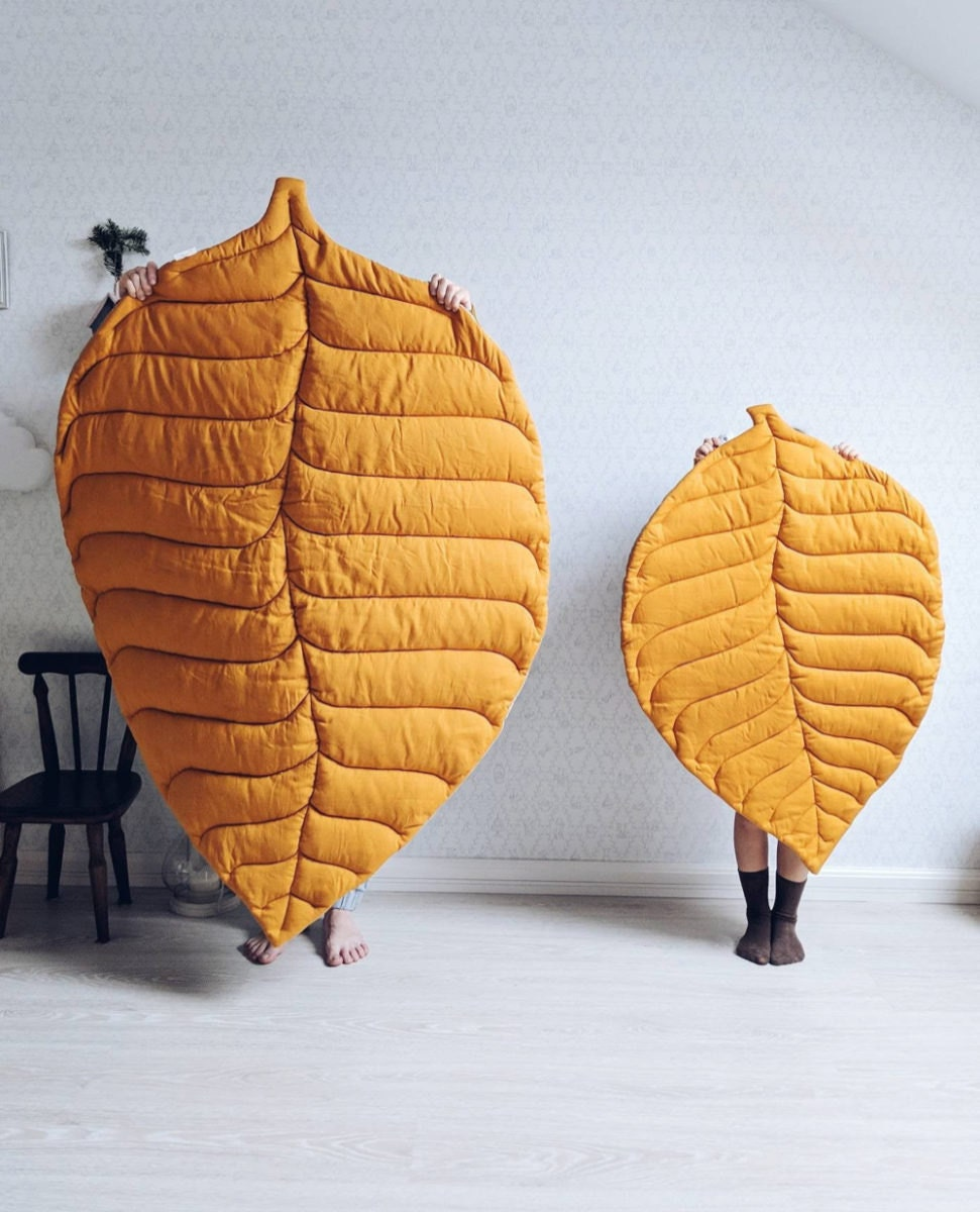 Leaf-shaped rugs from Etsy seller OMOLOKO
