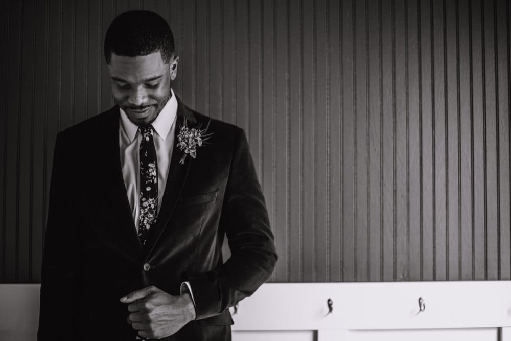 A black and white portrait of Terrell dressed up on his wedding day