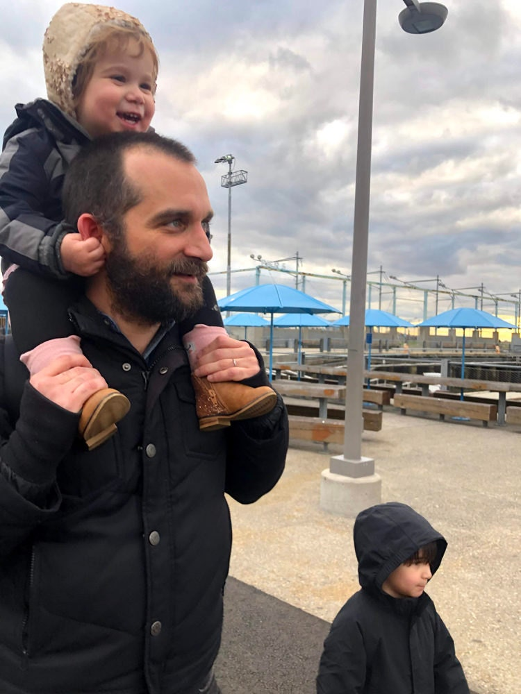 A portrait of Senior Security Engineer Brendan Adamson and his two kids.