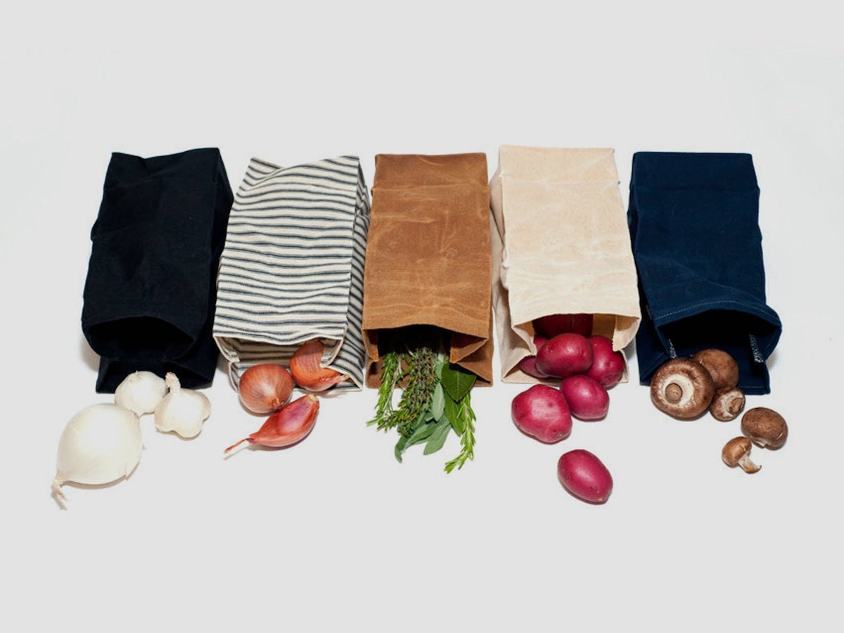 A lineup of waxed canvas produce bags in assorted earthy colors from WAAM Industries