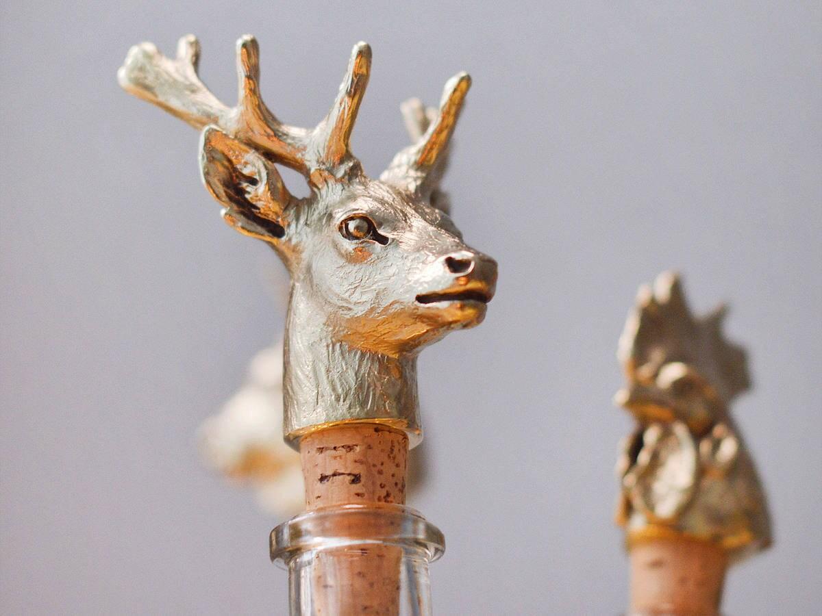Elegant brass bottle stopper sculpted in the shape of a deer head.