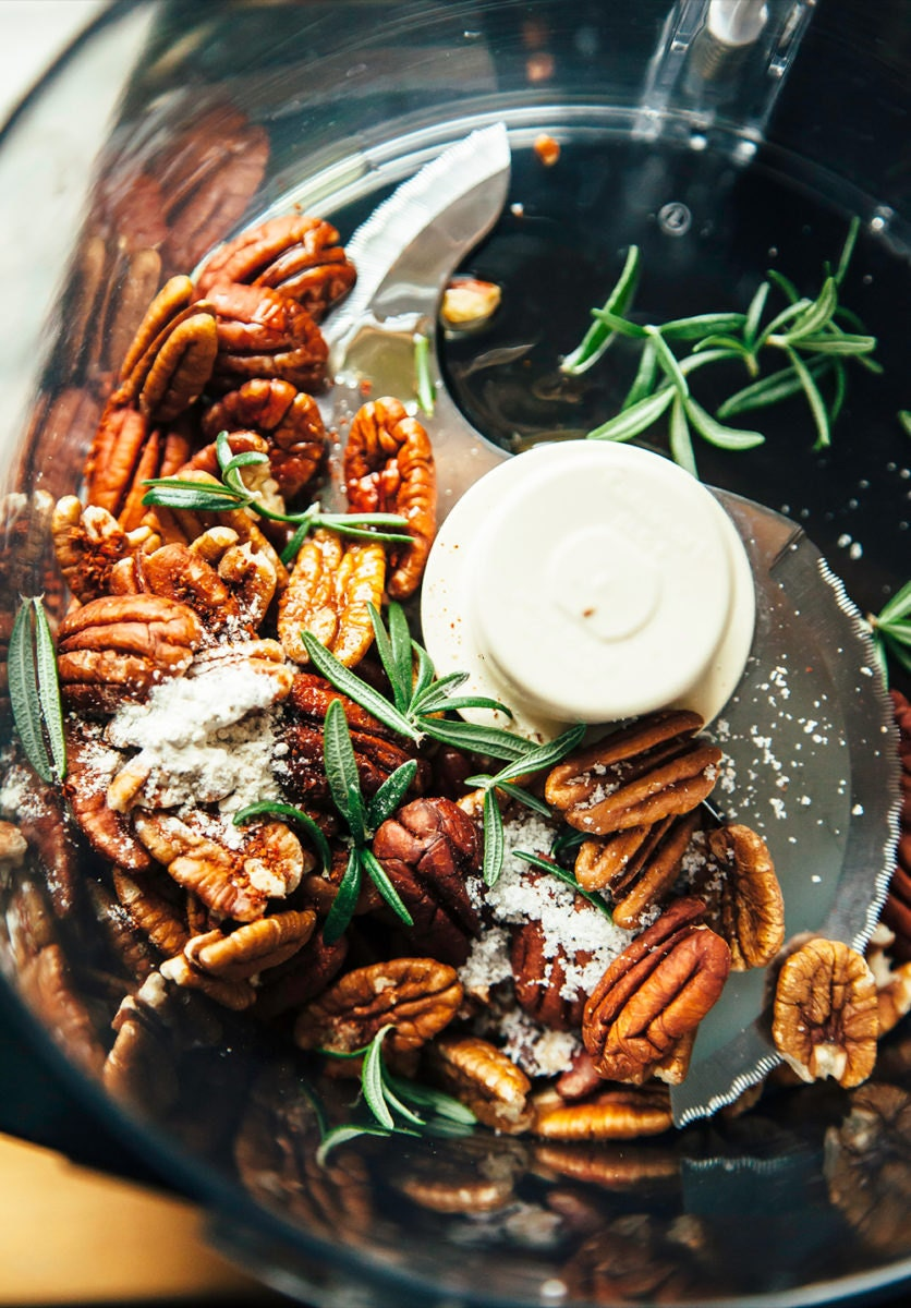 Pecans, rosemary, and garlic powder tossed in a food processor