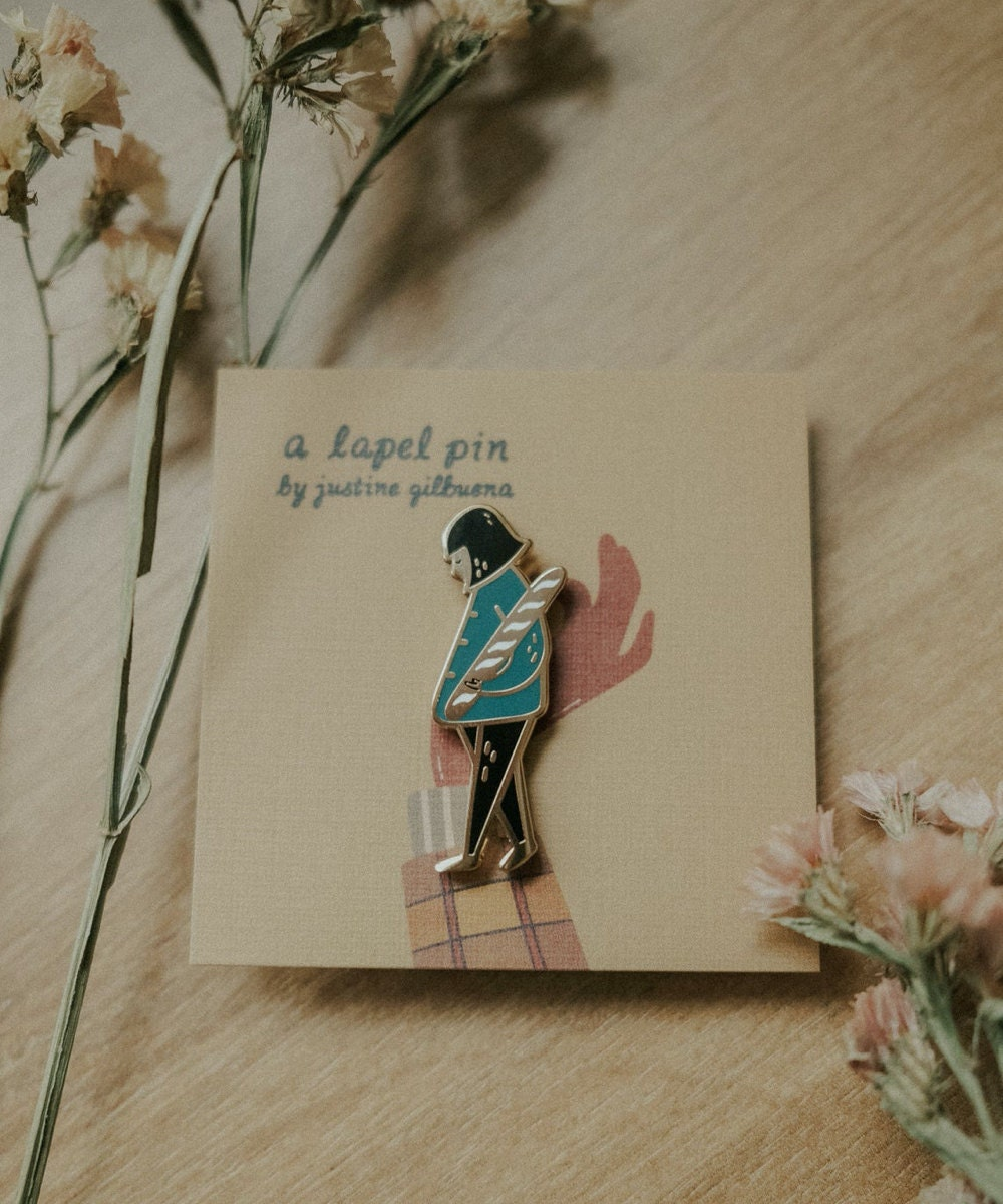 Girl with baguette enamel pin from Justine Gilbuena