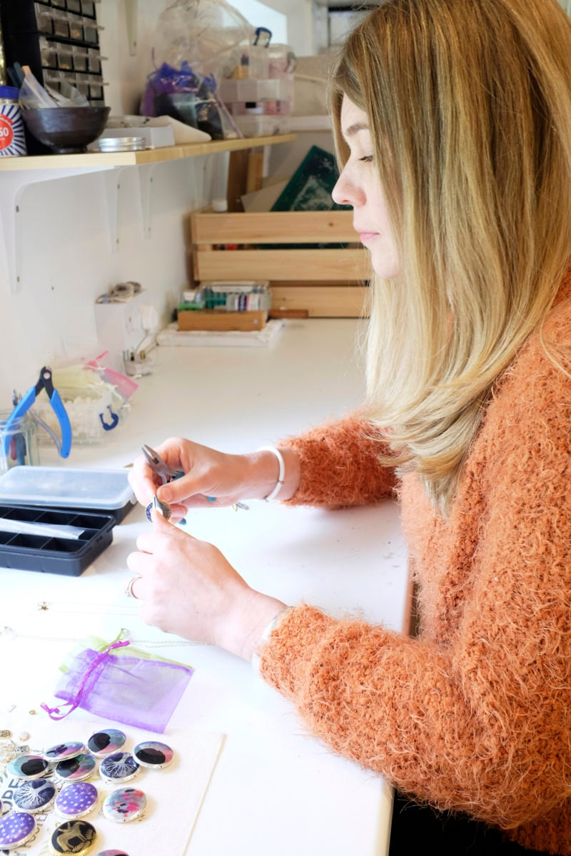 Lee works on assembling jewelry in her studio