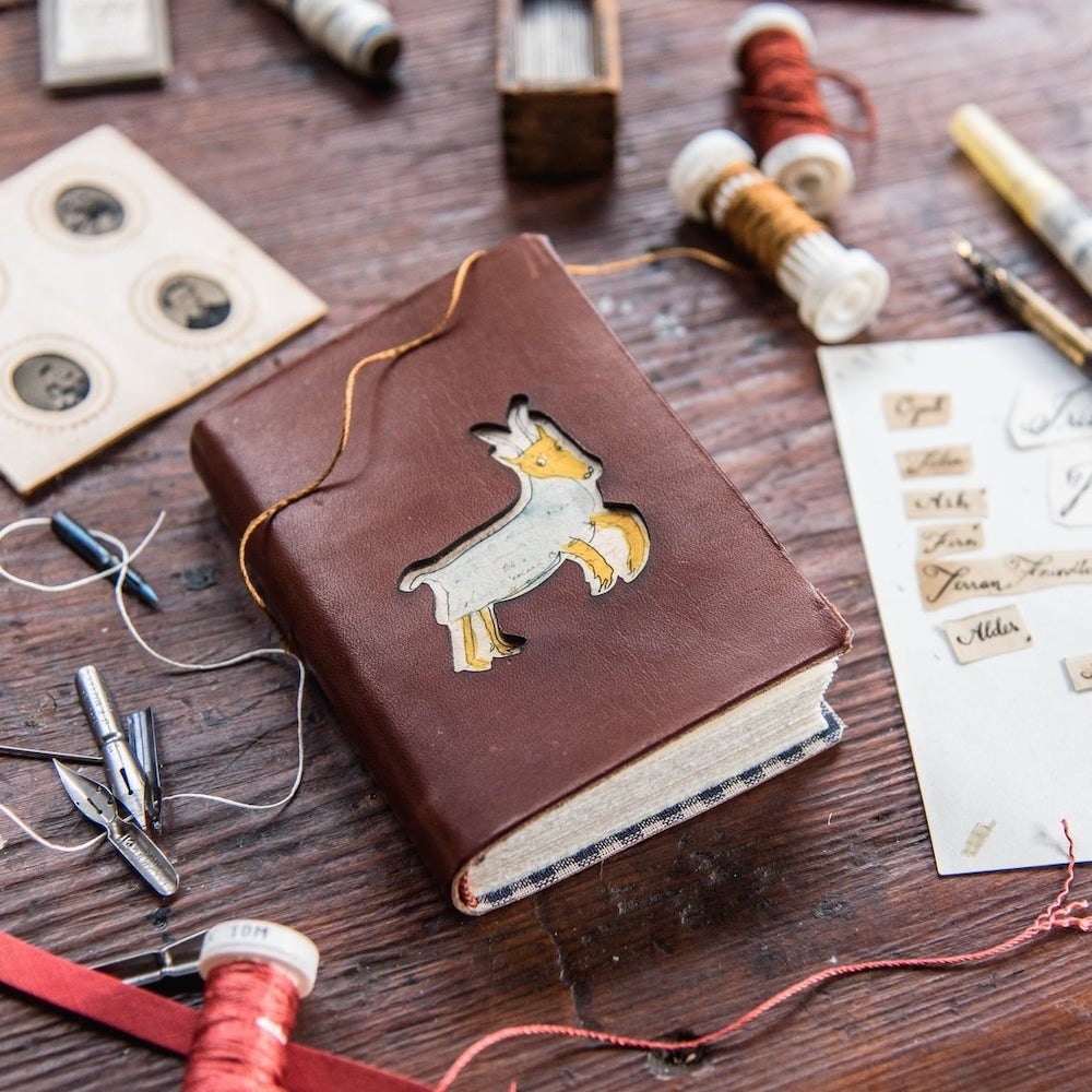 A hand-bound animal notebook from Peg and Awl