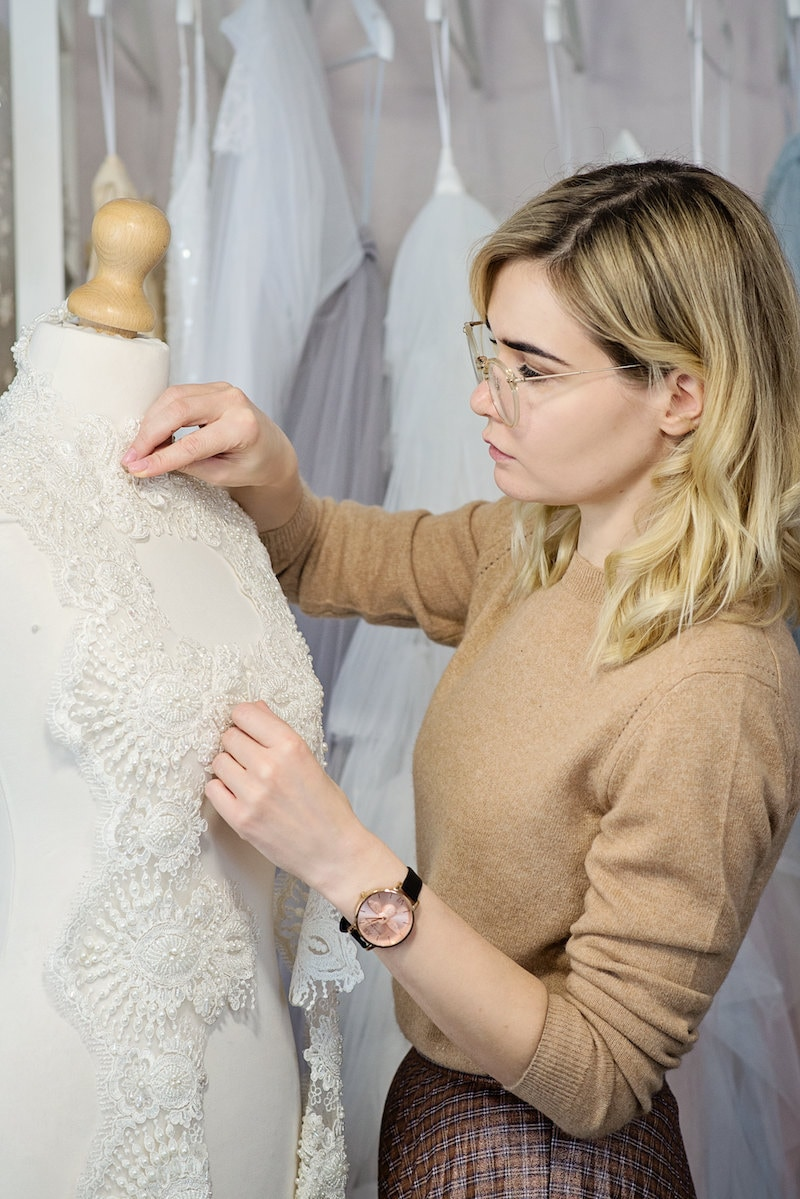 Inge pieces a lace bridal top together on a mannequin