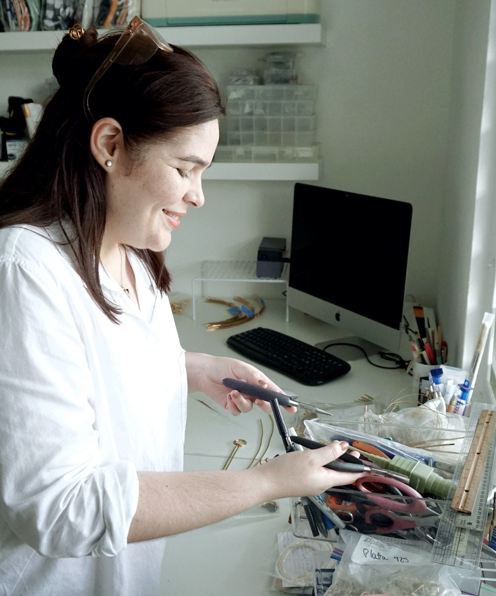 Aleishla choosing the right tool for the job in her Puerto Rico studio