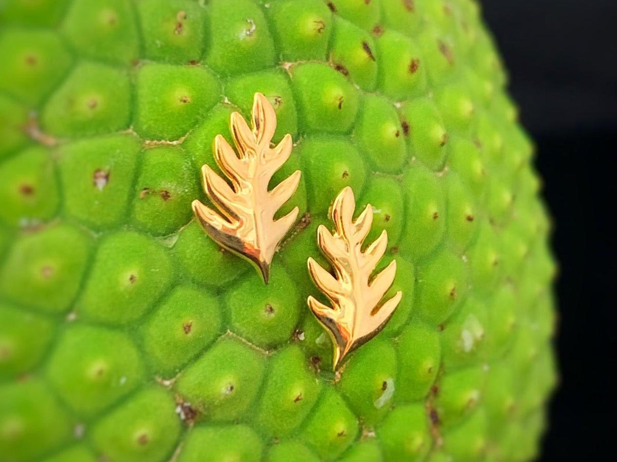 Gold ulu leaf earrings from Te Hotu Mana