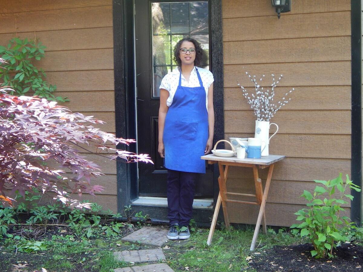 Edith standing outside of her studio's front door