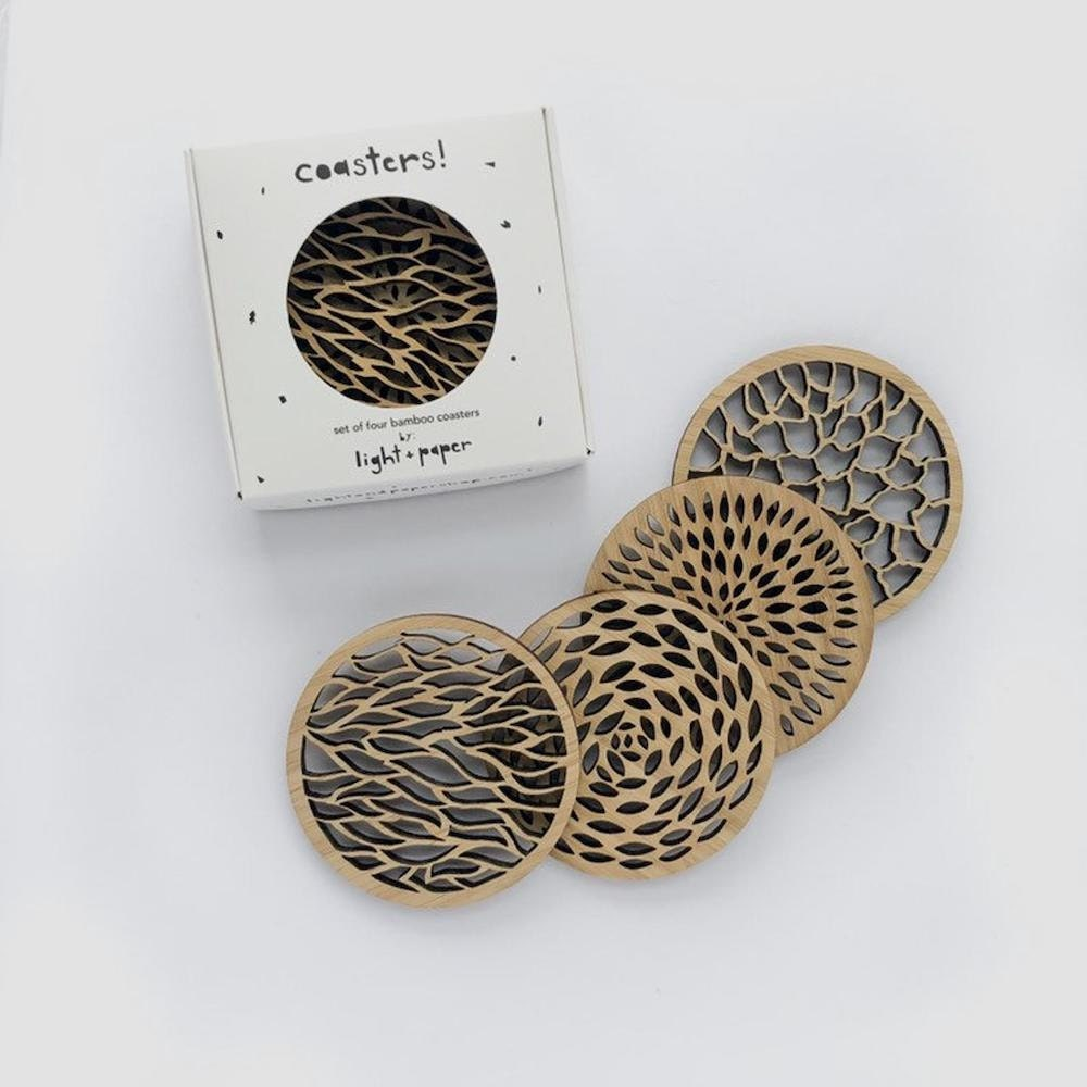 Assorted laser-cut wooden coasters from Light + Paper