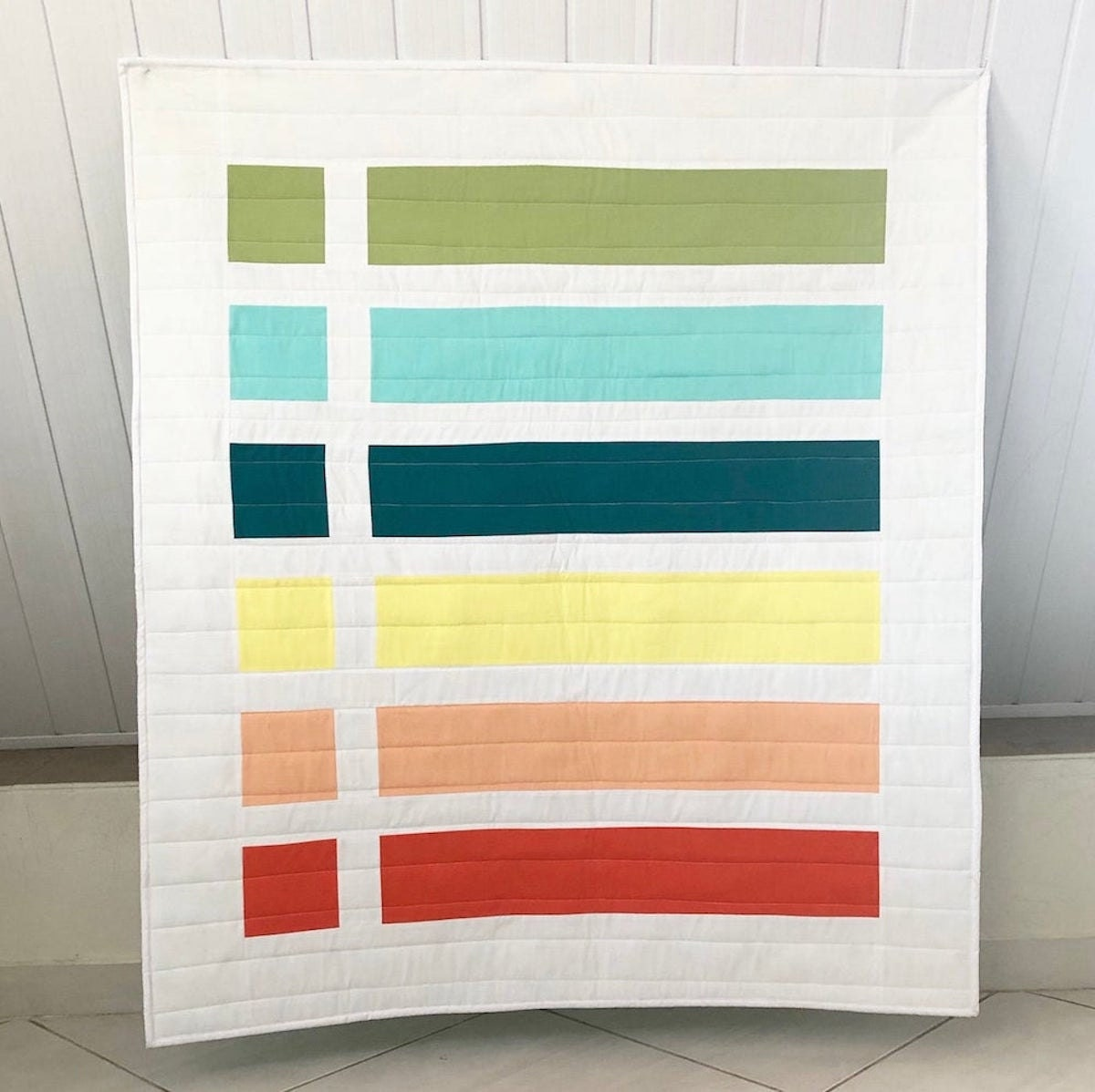 A colorful baby quilt kit from Etsy