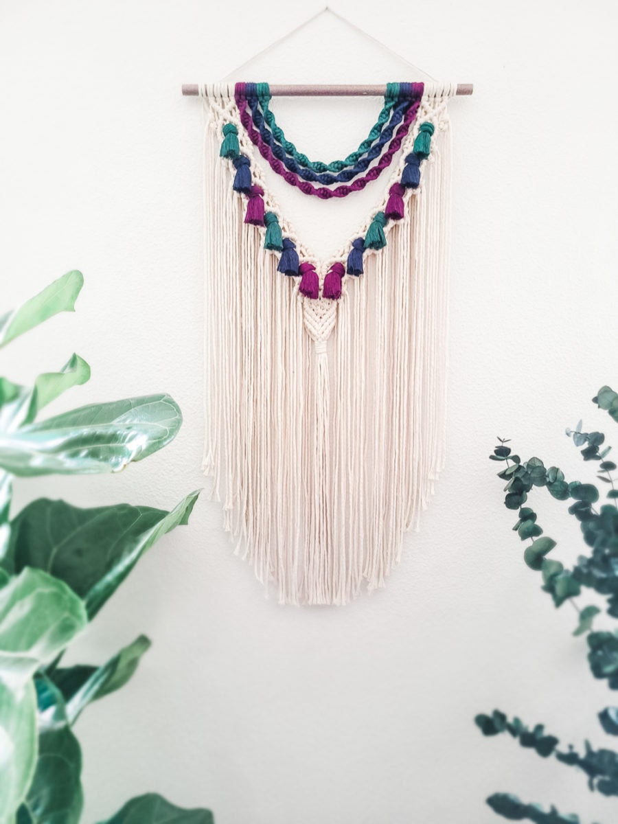 A macrame wall hanging with jewel tones from Sweet Home Alberti