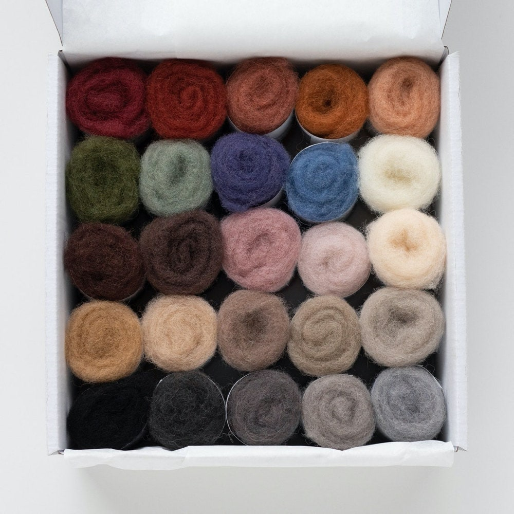 A box of 25 needle felting wool colors from Felted Sky
