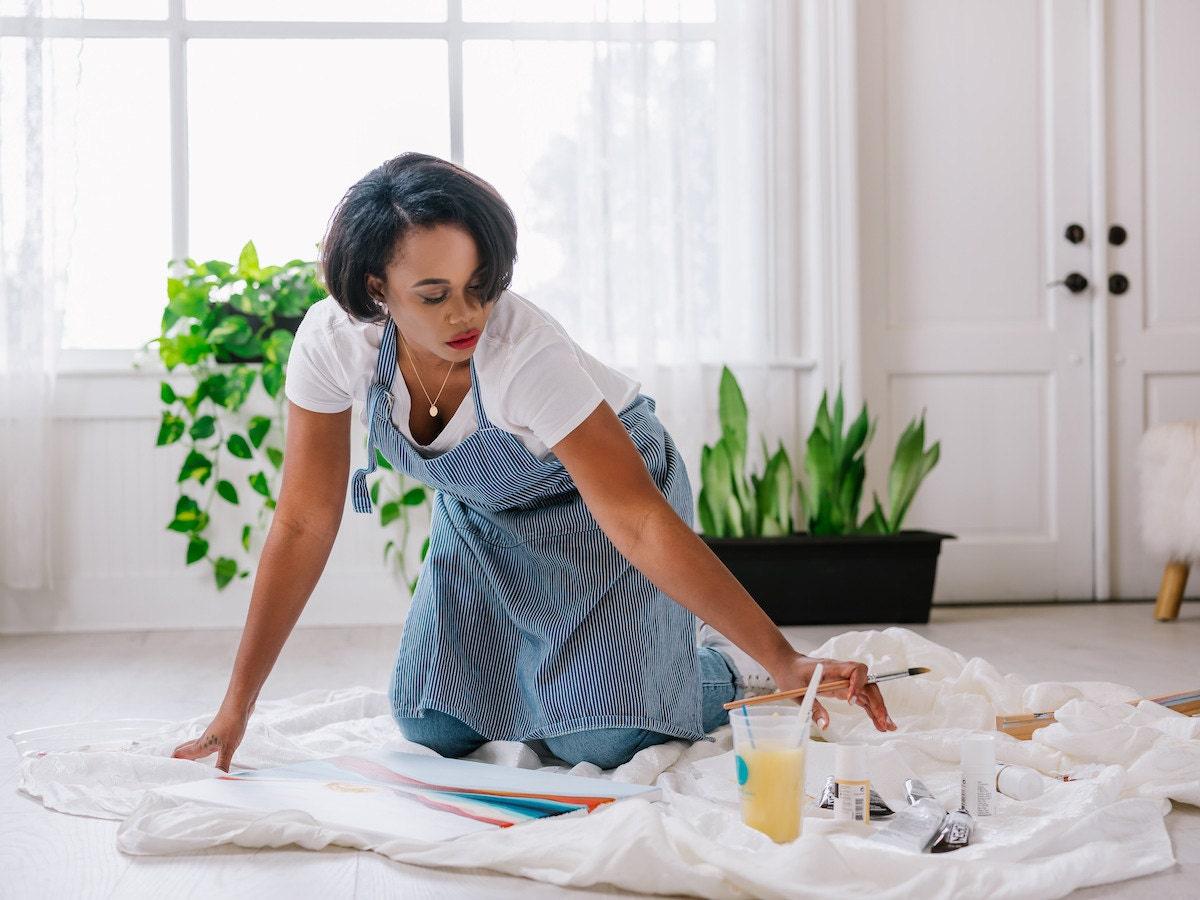 Melissa painting in her studio