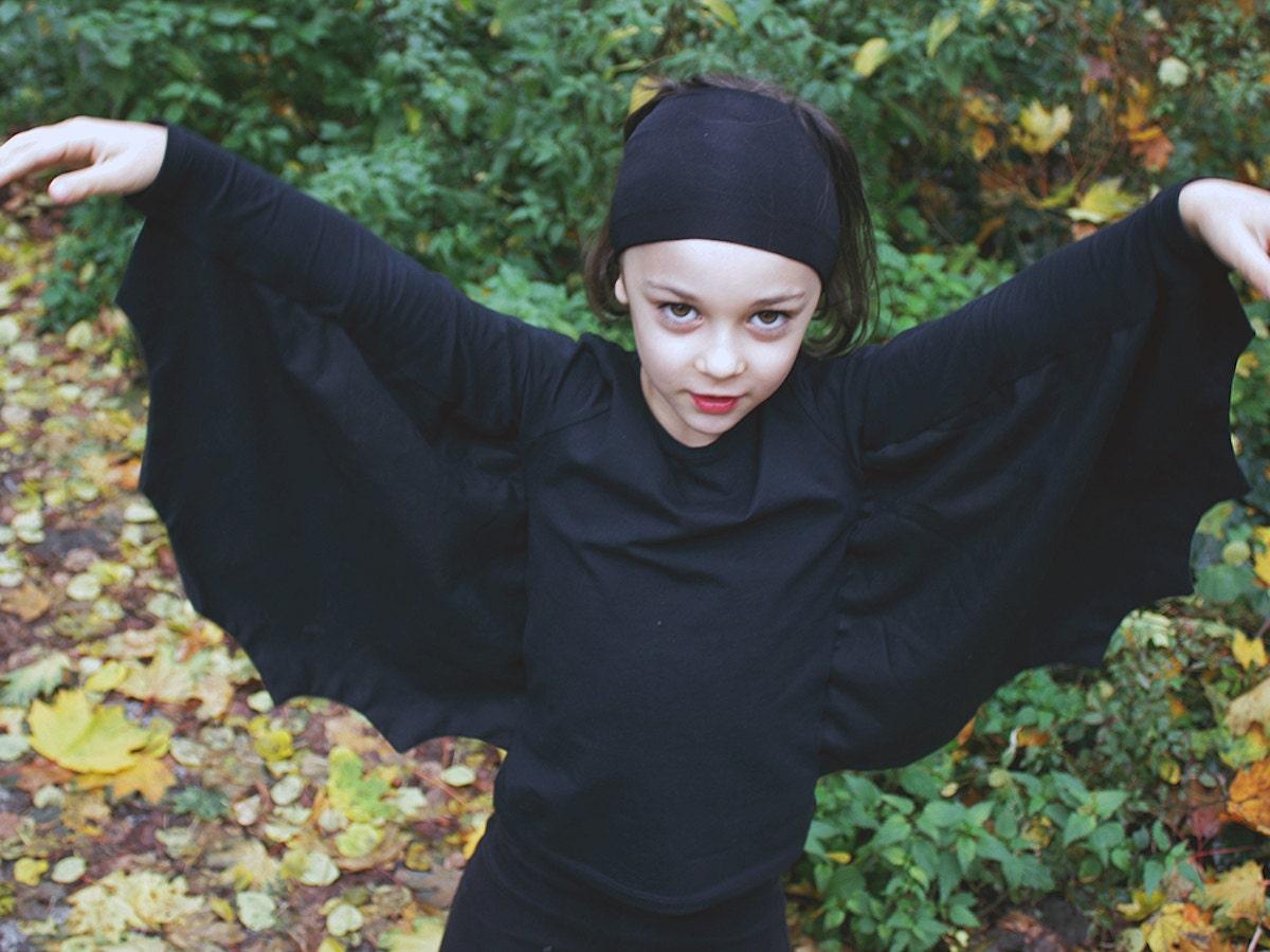 Child wearing DIY bat costume
