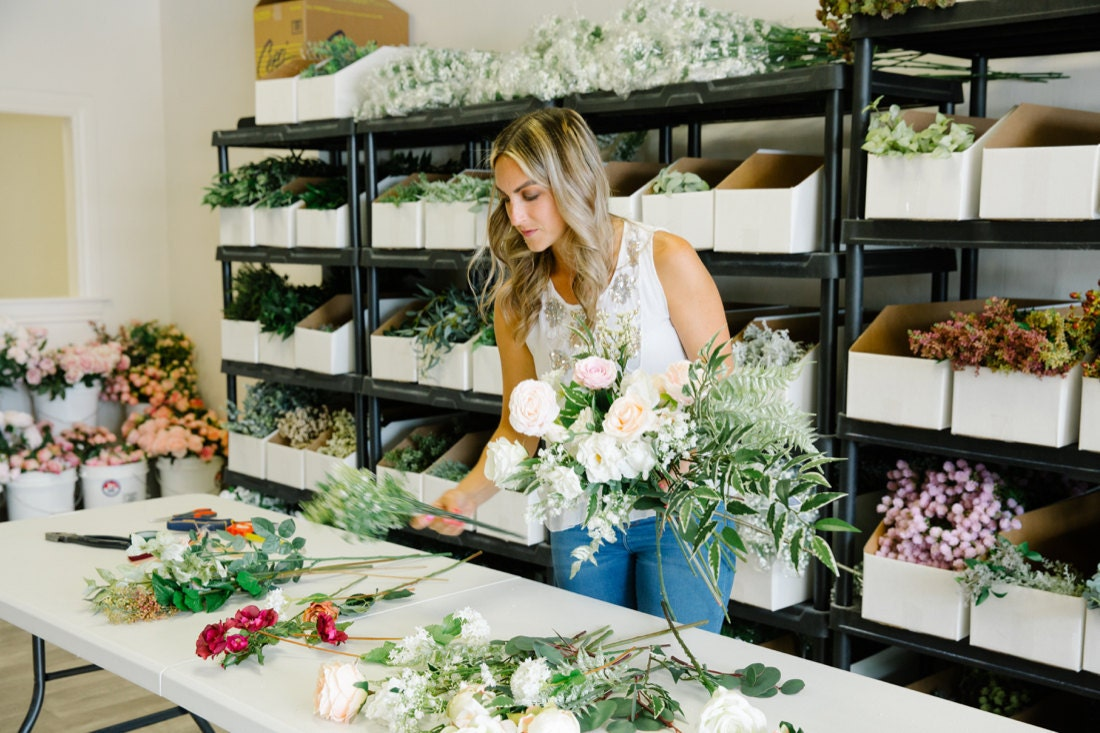 Brittany assembles a bouquet from various artificial stems