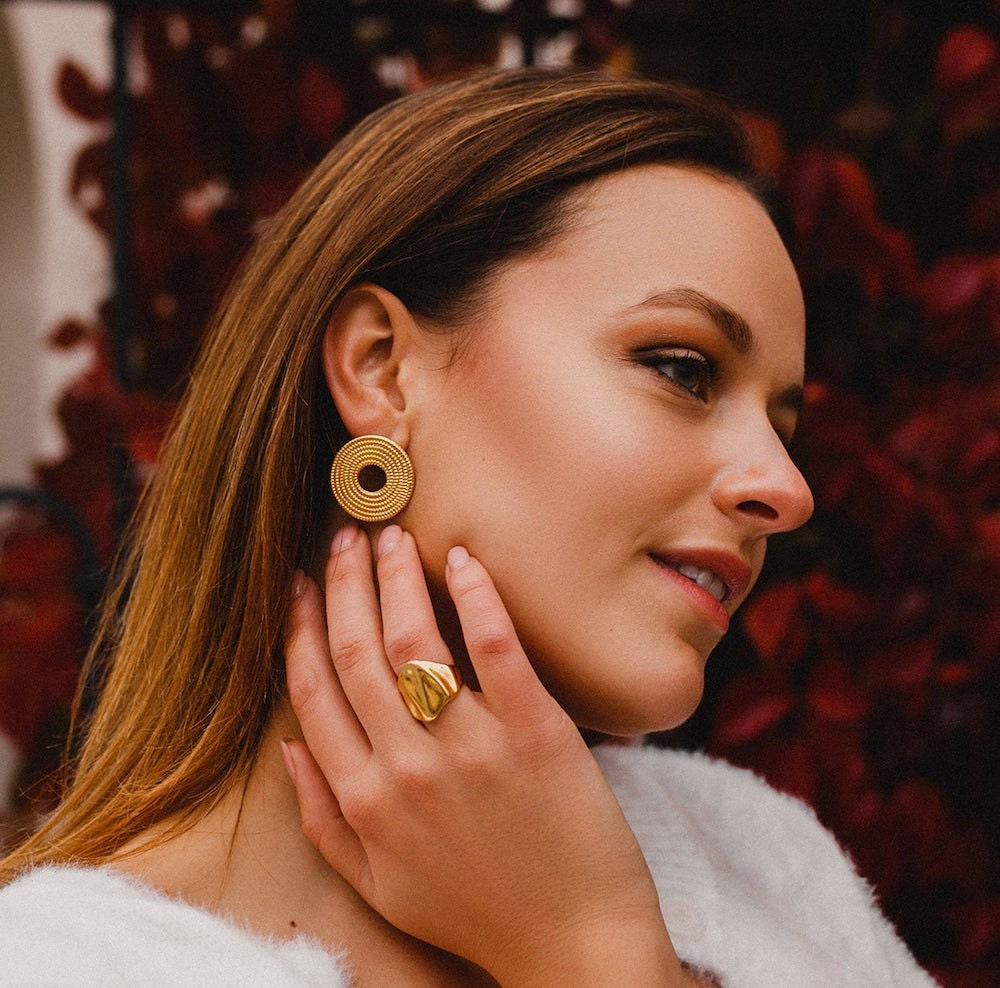 Modern disc earrings from V Christina Collection.