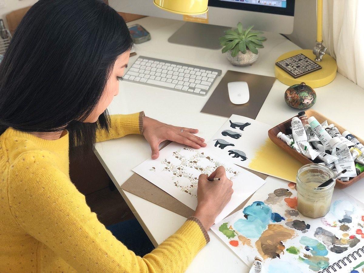 Jen illustrating a card design at her desk