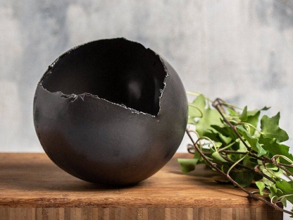 A black ceramic planter from Clay by Dannah